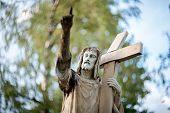 stock photo of sacred heart jesus  - Statue of Jesus Christ at Rasu cemetery in Vilnius Lithuania - JPG