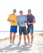 Постер, плакат: summer holidays vacation people and bachelor party concept group of happy male friends drinking