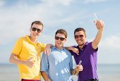 Постер, плакат: summer holidays vacation people and bachelor party concept group of happy male friends having fu