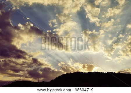 Beautiful Sky With Sunbeams And Dynamic Clouds At Sunset.