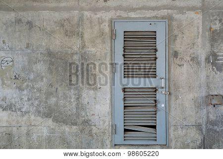 Grunge Grey Metal Or Steel Door On Old Concrete Wall.