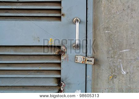 Closeup Metal Door With Lock In Grungy Style And Good Texture.