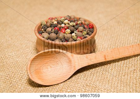 The Grains Of Pepper And Wooden Spoon On Old Cloth