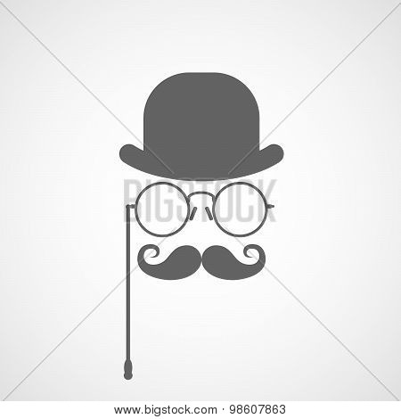 Silhouette of gentleman's face with twisted moustaches bowler and glasses