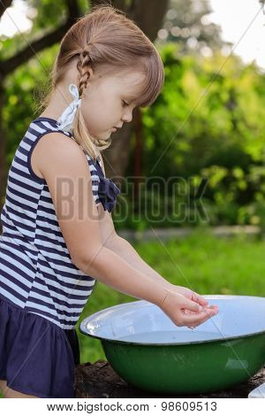 The Girl Washes His Face With Water From The Basin, Outdoor