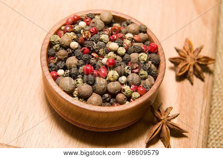The Grains Of Pepper And Star Anise On A Wooden Surface