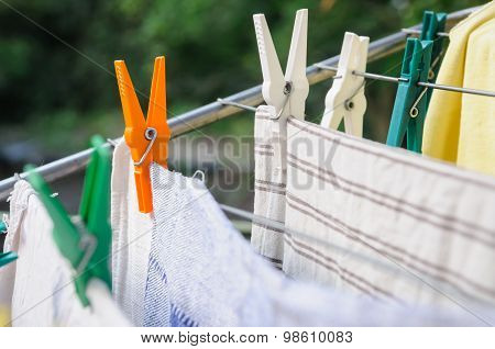 Laundry Pins And Hanged Clothes
