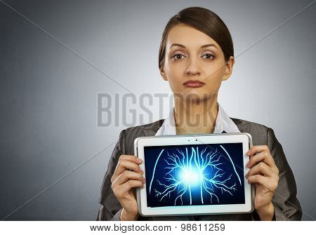 Woman holding tablet pc with lungs xray concept