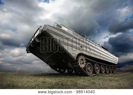 Military tank under sky