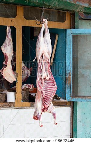Lamb Meat Hanging In A Butcher Shop. Srinagar, India
