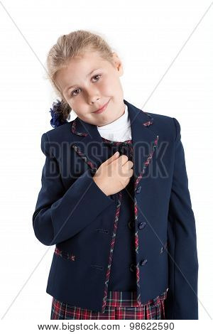 Portrait Of Caucasian Schoolgirl In Blue Uniform, Looking At Camera, Isolated On White Background
