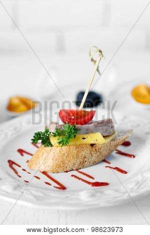 Tasty canape on wooden table, close up