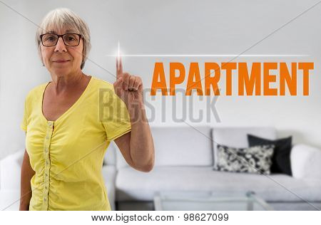Apartment Touchscreen Is Shown By Senior