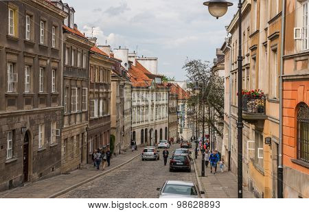 WARSAW, POLAND - JUNE 20, 2015:  Street in the old town near the market square. A popular place among tourists in June 20, 2015 in Warsaw, Poland.