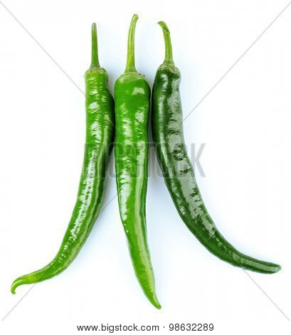 Green hot peppers isolated on white