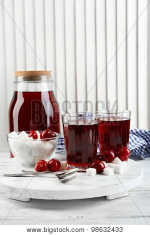 Ingredients for cherry compote on table, on light background