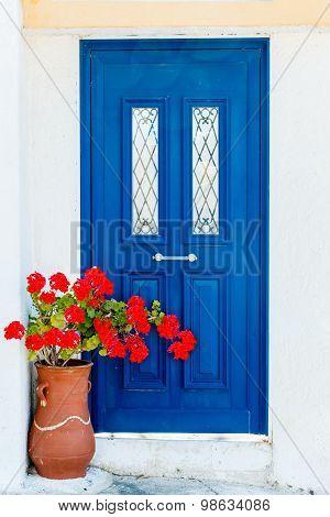 Greek House Door In With Geranium Flowers