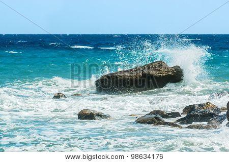 Moderate Sea Waves Hitting The Rocks
