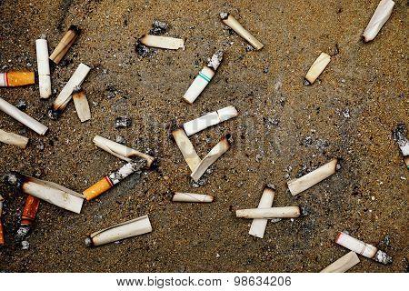 Cigarette Stub On Sand