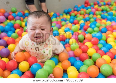 Crying Baby Girl In Ball Pit