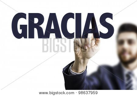 Business man pointing the text: Thank You (in Spanish)