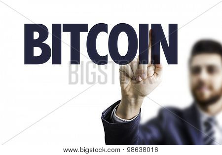 Business man pointing the text: Bitcoin