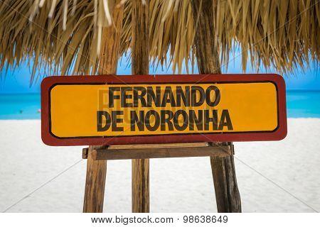 Fernando de Noronha sign with beach background