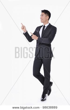 full body picture of a happy business man presenting something on a white background