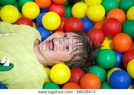 Little Boy In The Children's Playground