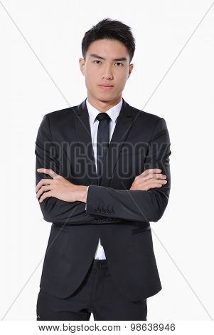 young businessman with crossed arms