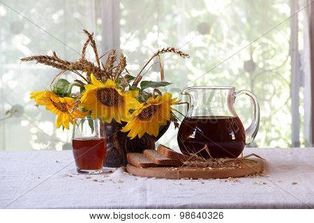 Kvass (kvas) In A Transparent Jug, Rye Bread And A Bouquet Of Sunflowers