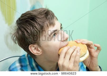 Teenager With Burger