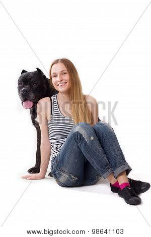 Girl Sits On Floor. Her Dog Cane Corso Sitting At Her. Looking Camera