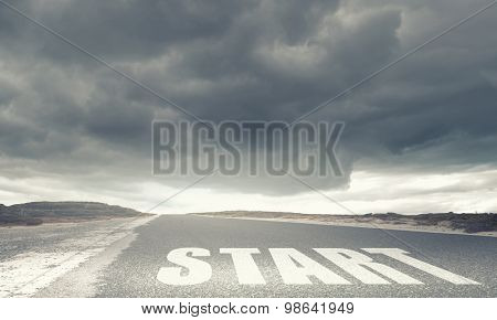 Conceptual image with word start on asphalt road