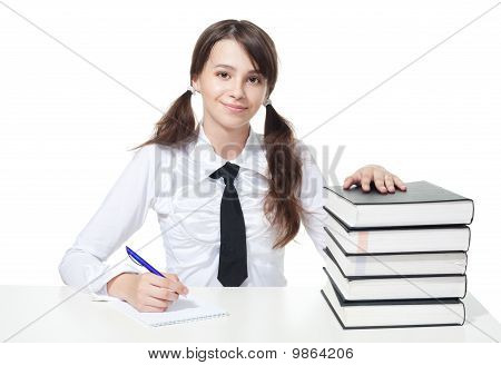 Happy Schoolgirl With Stack Of Books