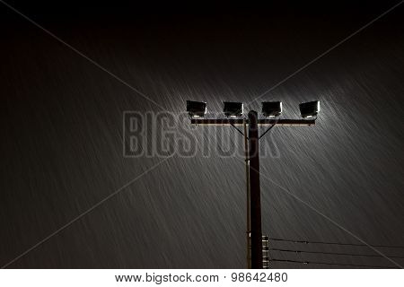Soft shot of Night Street lamp lights in Heavy rain, Rainstorm,Grained Image.