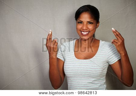 Young African Woman Crossing Fingers While Smiling