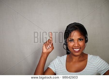 Young Receptionist Pointing Up While Smiling