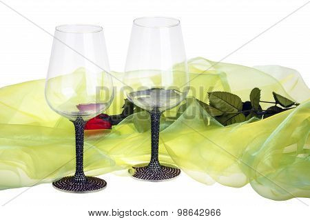 Close-up of two wine glasses with red rose
