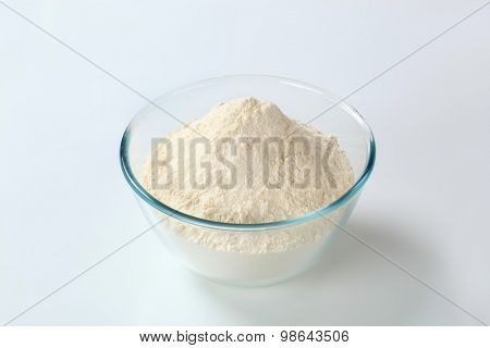 white wheat flour in a small glass bowl