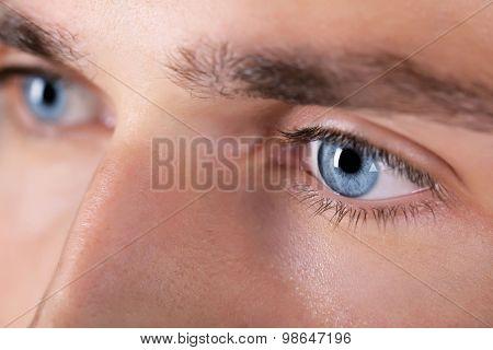 Beautiful blue man eyes close up