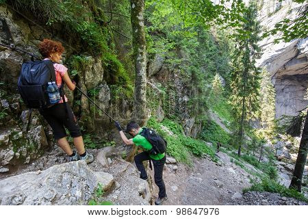 Hikers On A Perilous Trail, Holding The Safety Line