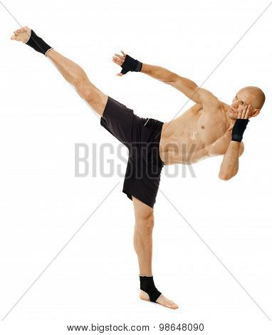 Kickboxer Executing A Powerful Kick