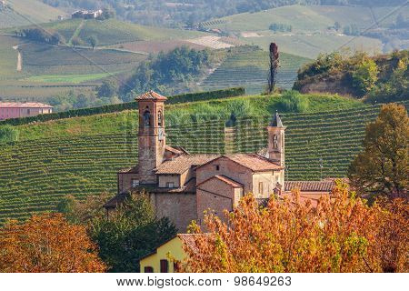Old medieval church in small town of Barolo in Piedmont, Northern Italy.