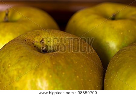 Close-up of apples on old wooden shelf at late autumn