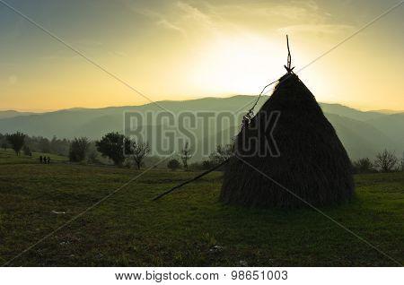 Trekking through mountain meadows near Danube river at sunset