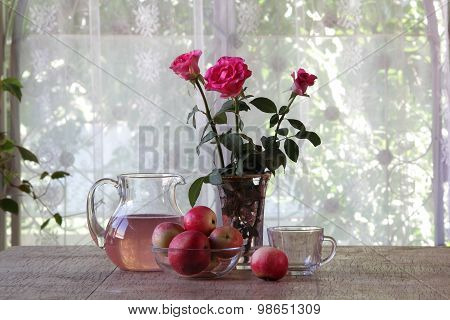 Compote From Apples In A Transparent Jug On A Wooden Table