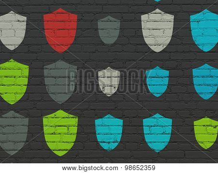 Security concept: Shield icons on wall background