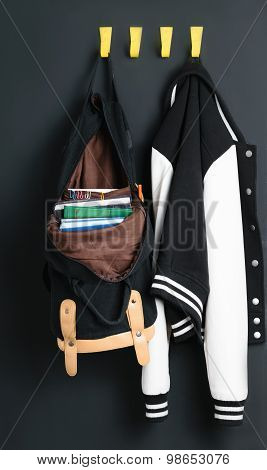 Backpack and jacket on the wall
