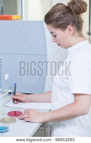 Female Scientist Doing Experiment